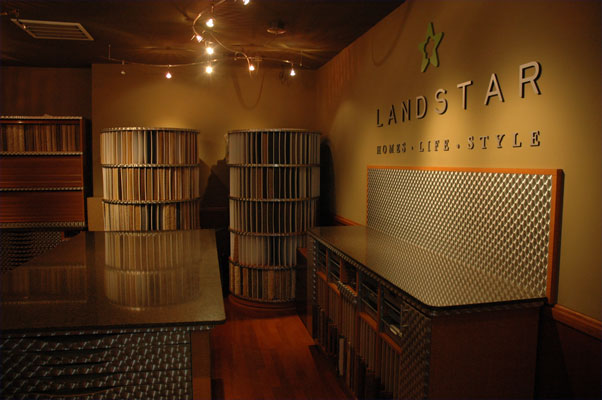 The Landstar Homes showroom showing carpet samples and metal countertops