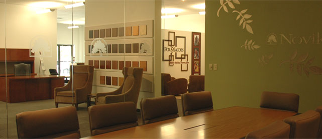 The Novikoff Furniture showroom conference room with a large table and six executive chairs