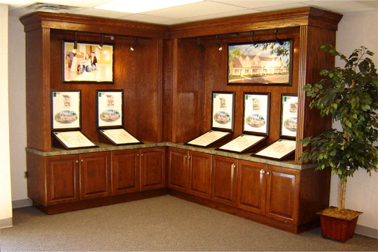 A custom wood cabinet displaying house floorplans and elevations