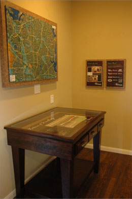 A large rectangular site map table with three drawers